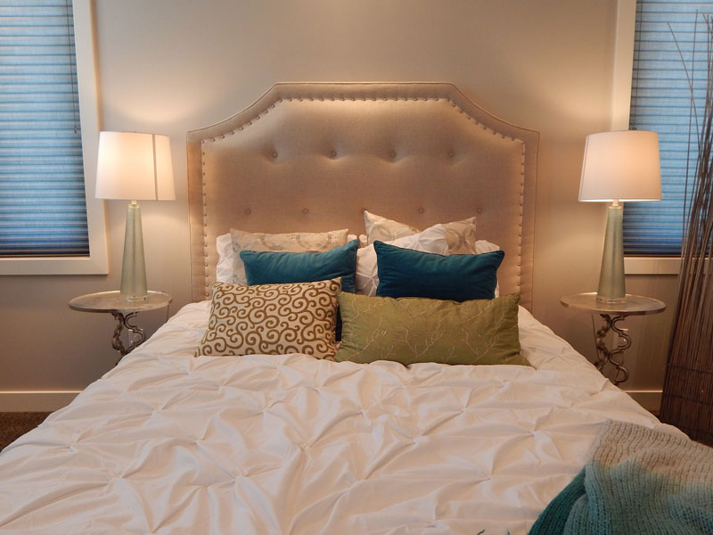 Beautiful bed with mattress and pillow.