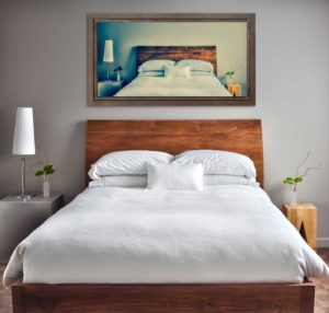 clean-and-modern-bedroom-with-fun-canvas-on-the-PWRBRRD