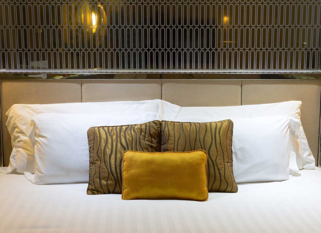 pillows-on-beds-in-hotel-PQKFXQN